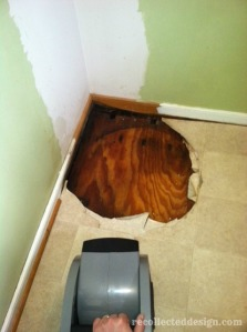 ...the drying of the floor underneath and the corner behind that had never been painted...